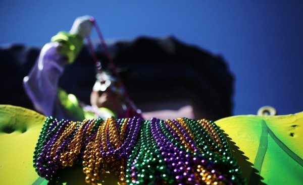 epa05148483 Beads hang from the side of a float while a masked throws beads during the Krewe of Okeanos parade in New Orleans, Louisiana, USA on 07 February 2016. New Orleans is celebrating Mardi Gras leading up to Fat Tuesday. EPA/DAN ANDERSON