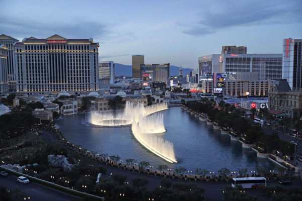 File - In this April 4, 2017, file photo, the fountains of Bellagio erupt along the Las Vegas Strip in Las Vegas. The Nevada Gaming Control Board reported Thursday, July 27, 2017, that casino gambling revenues totaled $895 million in June, up just under 1 percent statewide from the same month last year. (AP Photo/John Locher, File)